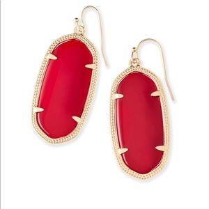 Red Kendra Scott earrings.